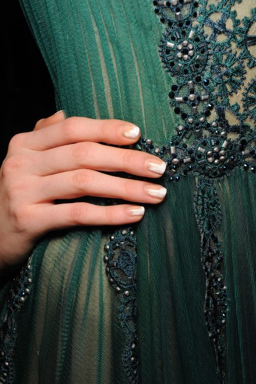 <p>Hughes used butter LONDON Cotton Buds and Full Monty for the soft nail art look at Tadashi Shoji.</p>