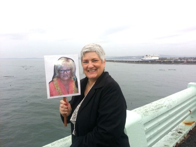 """<p>Tami Schmidt: """"Once we realized that Vicki wouldn't be able to come to Victoria, B.C. for the visit we had planned, 3 of us who had been on the 2013 NTP Hawaiian cruise decided to put a life size photo of her on a stick and take her with us so she'd be in our photos.""""</p>"""