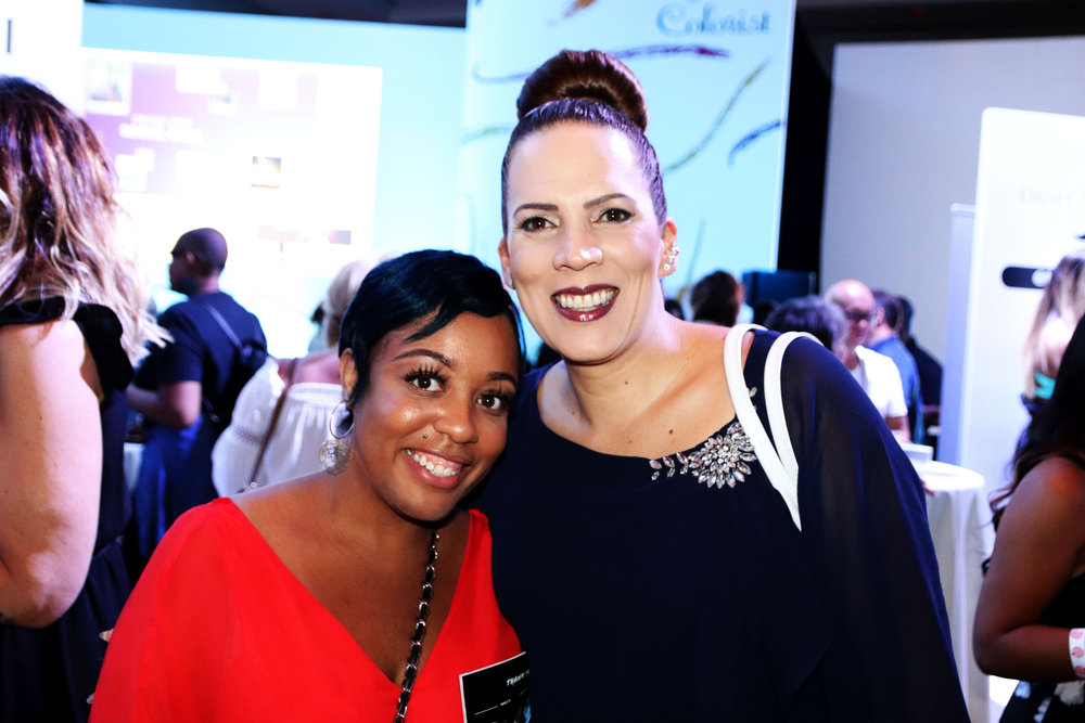 <p>An attendee and Tracey Lee post for a photo</p>