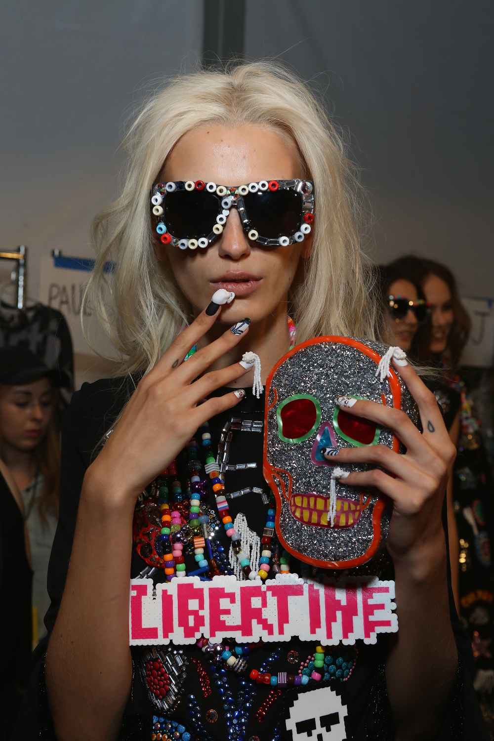 <p>Nails for Libertine were constructed on medium length, almond shaped nails, painted with VINYLUX and tricked out with unconventional materials like seed bead tassels and crystals. Photo courtesy of CND.</p>
