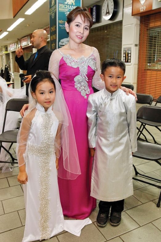 <p>Cynthia Bui's (center) daughter Courtney and nepher Aidan were the youngest models of the night.</p>