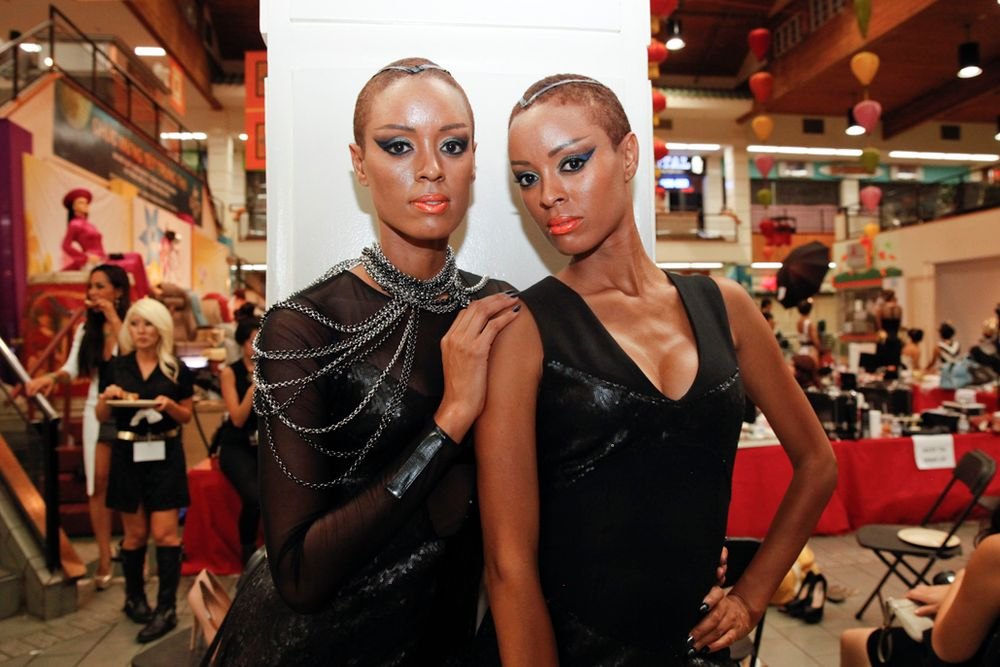 <p>Models for the Sahika Twins collection, and twins themselves, wait for their turn on the runway.</p>