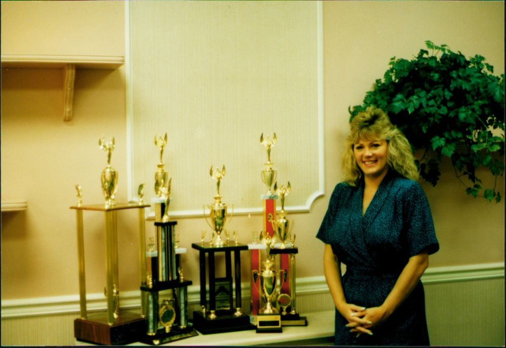 <p>Vicki with her competition photos (sometime in the mid-1980s)</p>