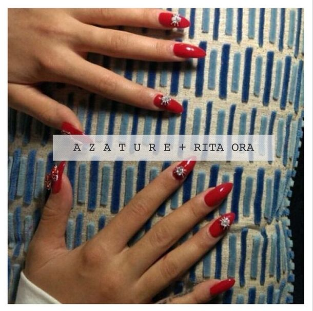 <p>Oh and did we mention that Ora's manicure cost $56,000? Celebrity nail artist Barbara Warner used Azature ruby and diamond polish to create this ultra luxe look. Image via @azature. &nbsp;</p>