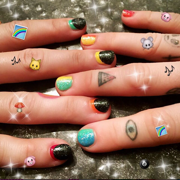 <p>Steph Stone polished Miley Cyrus's nails with a rainbow gradient consisting of NCLA and Chanel for her VMA hosting duties.</p>