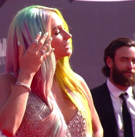 <p>Kesha flaunted an aqua manicure that matched her multi colored locks. Image via @mtv.</p>