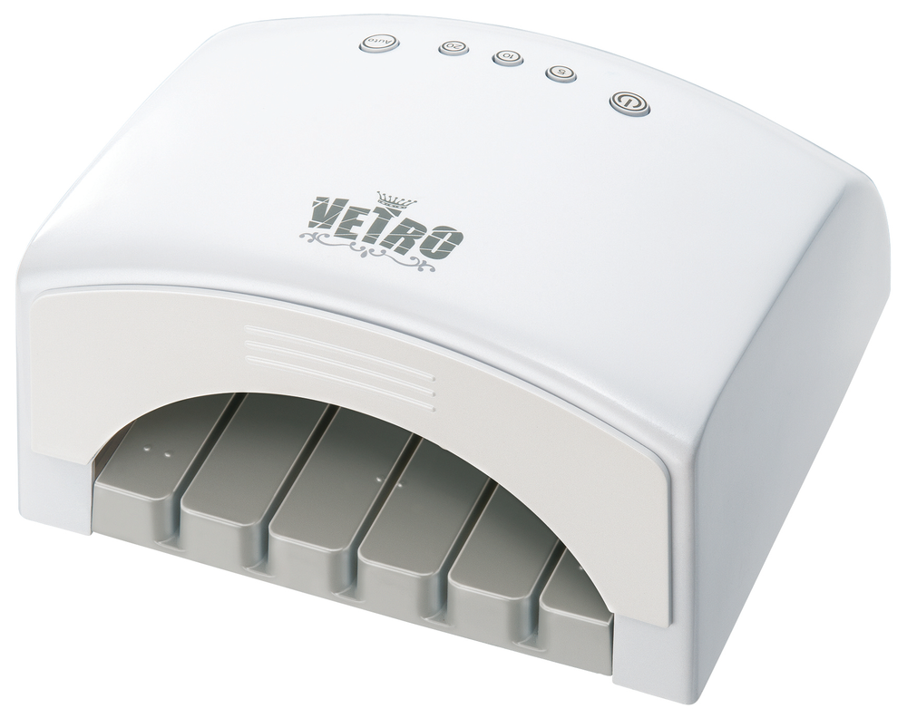"""<p><a href=""""http://www.vetro19.com/"""">Vetro</a>&rsquo;s LED lamp runs at 54 watts and has 5-, 10-, and 20-second cure settings. The removable bottom has grooves built in so nail extensions can cure with the form on them. Inside the hand plate are raised dots so the client can feel where her fingers should go.</p>"""