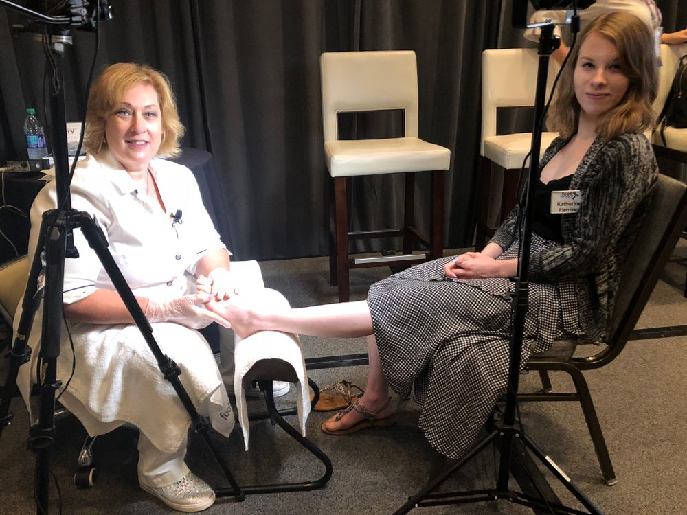<p>Vicki Malo demoes the BS brace on NAILS associate editor Katherine Fleming</p>