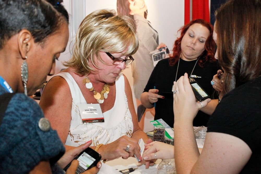 <p>Vicki demos products at the Kupa Inc. booth</p>