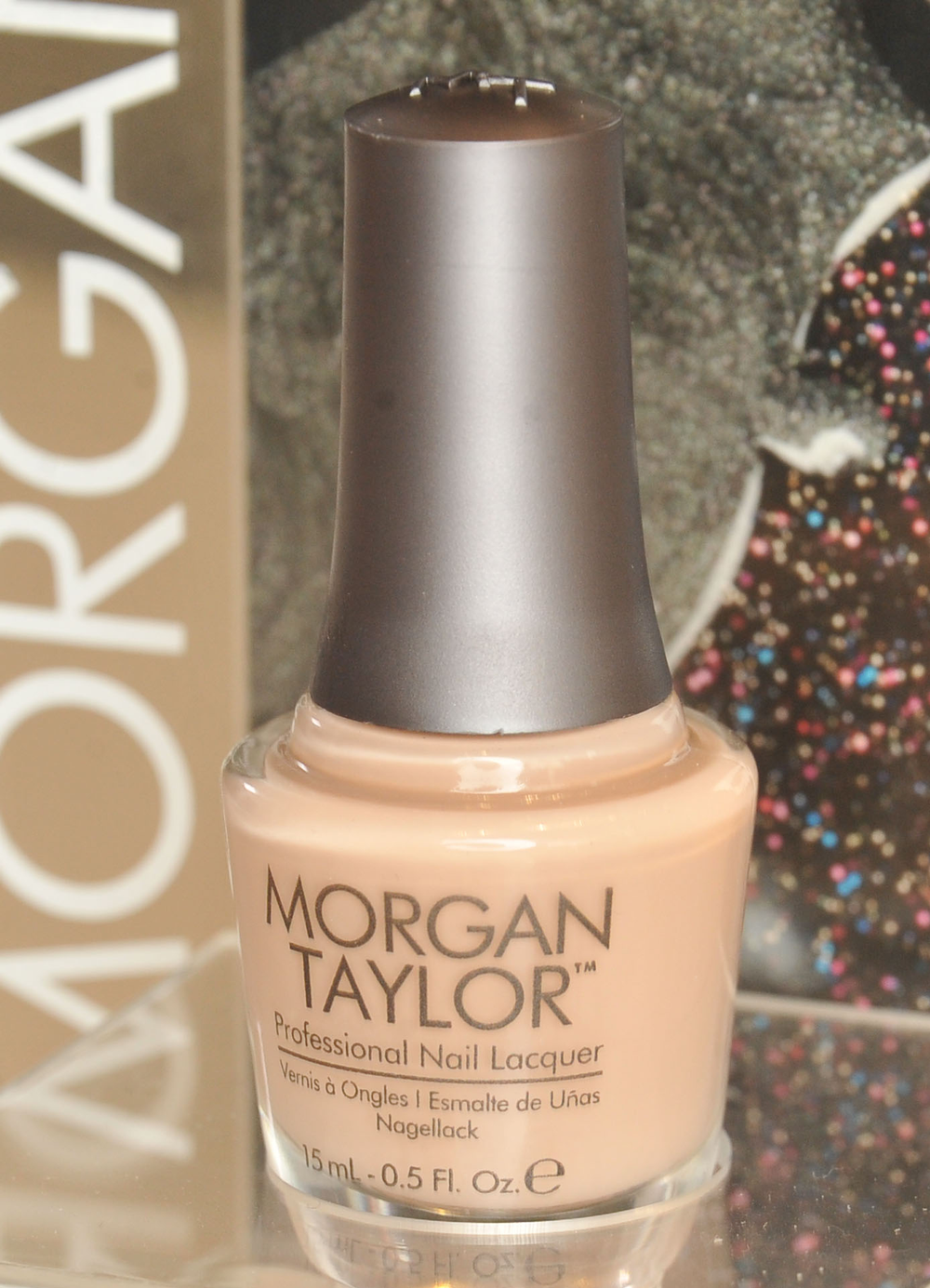 <p>Lead manicurist Gina Edwards kept it clean with two coats of <strong>Morgan Taylor </strong>in New School Nude. Photo courtesy of Morgan Taylor.&nbsp;</p>