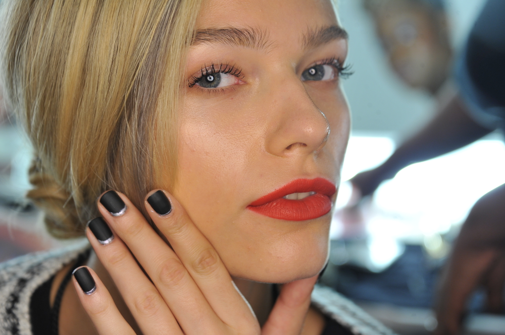<p>Little Black Dress&nbsp;was muted by Mattes A Wrap top coat then the cuticle line was edged with&nbsp;Oh Snap, It's Silver, an iridescent silver for Carmen Marc Valvo. Photo courtesy of Morgan Taylor.</p>