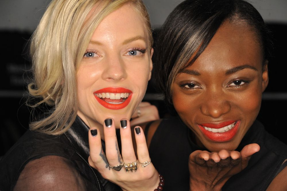 <p>Celebrating the designer's silver anniversary, Gina Edwards created a sophisticated dual-finish black and silver manicure for Carmen Marc Valvo.&nbsp;Photo courtesy of Morgan Taylor.&nbsp;</p>