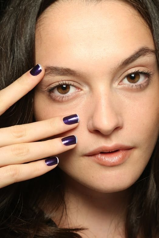 <p>Zang Toi opted for a modern French, pairing a purple metallic gem shade (Belinda) with a thin delicate curve of Kendal at the tip. Photo courtesy of ZOYA.</p>