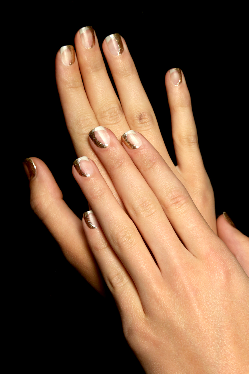 <p>No base coat was used so that the nails at Zimmerman would look naked and not too shiny. Paint the teardrop portion of the nail using Ziv, leaving the rest of the nail bare. Photo courtesy of ZOYA.</p>