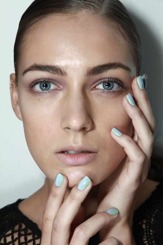 <p>Zoya Blu combined with a custom pastel green and lavender to create a side part at Rolando Santana. Photo courtesy of ZOYA.</p>