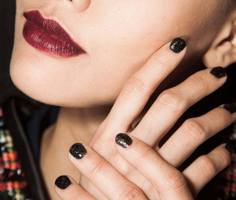 <p>Zoya's black on black glitter look was created for Zang Toi's second set of runway nails. Image courtesy of Zoya Nail Polish.</p>