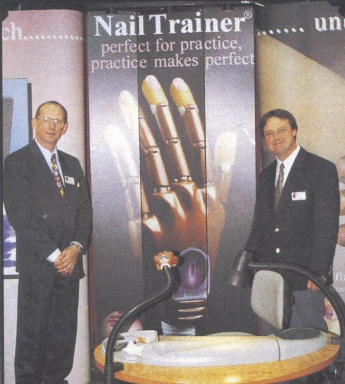 <p>Demonstrating the latest in nail technician training techniques, Englishmen Dave Simmons (left) and John Grace, makers of The Nail Trainer, say their version of the practice hand gets nail technicians ready for the salon floor in six weeks.</p>