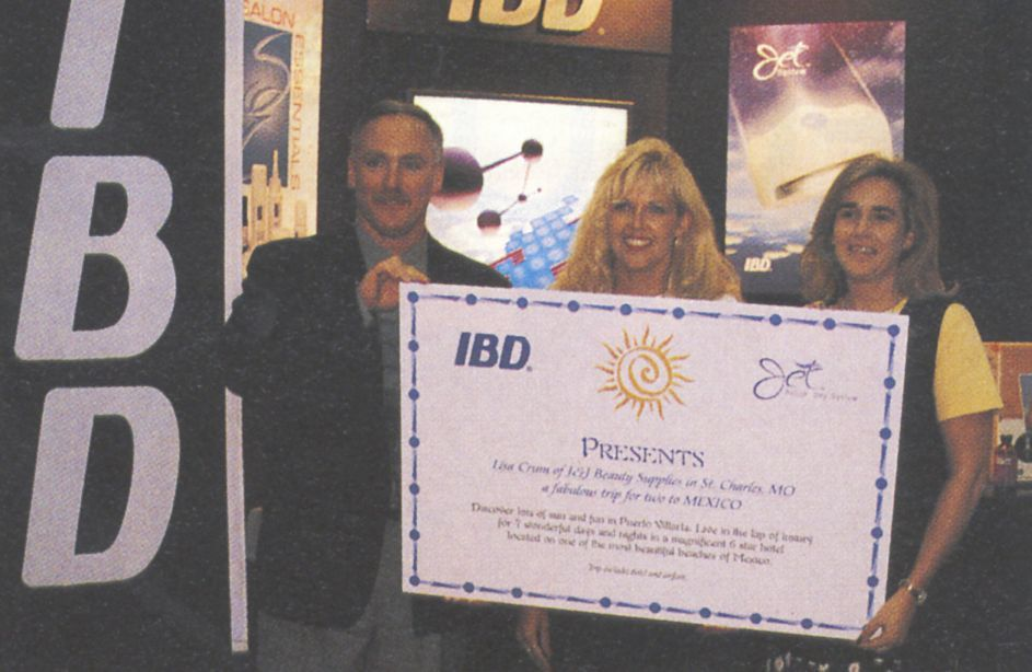 <p>Lisa Crum (middle) of J&amp;J Beauty Supplies in St. Charles, MO.,  and a guest will head for a 7-day trip to Puerto Vallarta, compliments  of IBD (company president Lee Tomlinson is on left).</p>