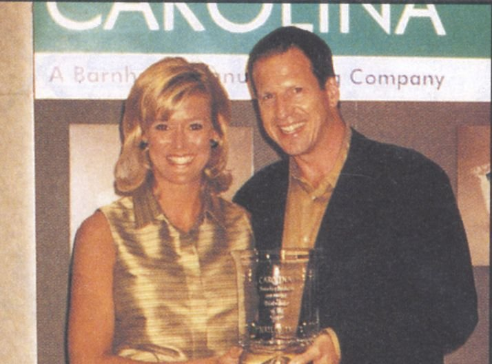 <p>Carolina's Kristel Dean presents Nailco's present Larry Gaynor with the 1997-98 DIstributor of the Year Award.</p>
