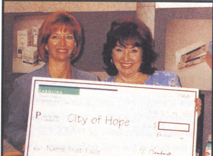 <p>Carolina Beauty Products presents the $220 check to Janine McDonough, manager of the City of Hope Positive Image Center.</p>
