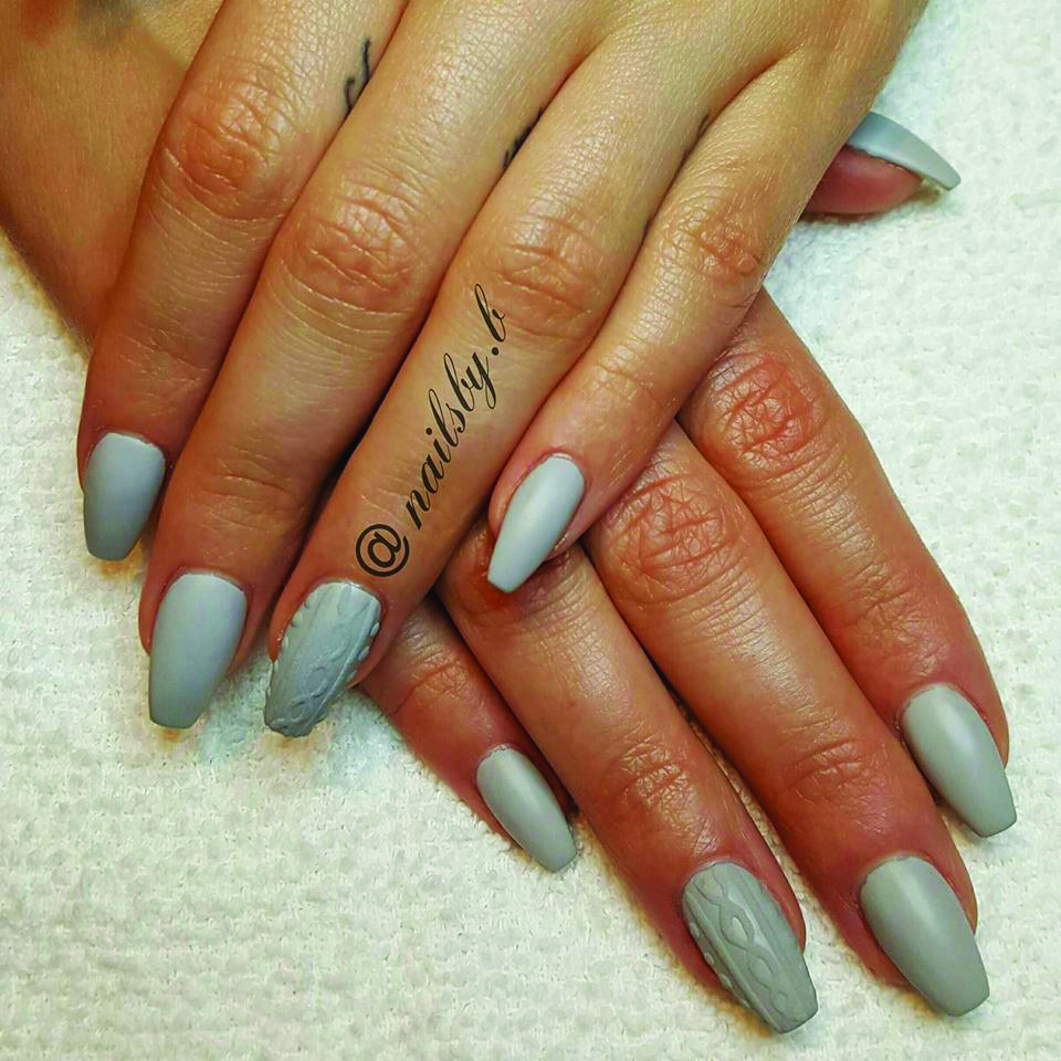 <p>TAOND student Brittany Cahill created these monotone textured nails.</p>