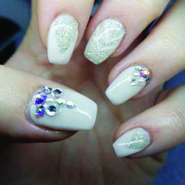 <p>TAOND student Chanell Christoffersen created these embellished nails.</p>