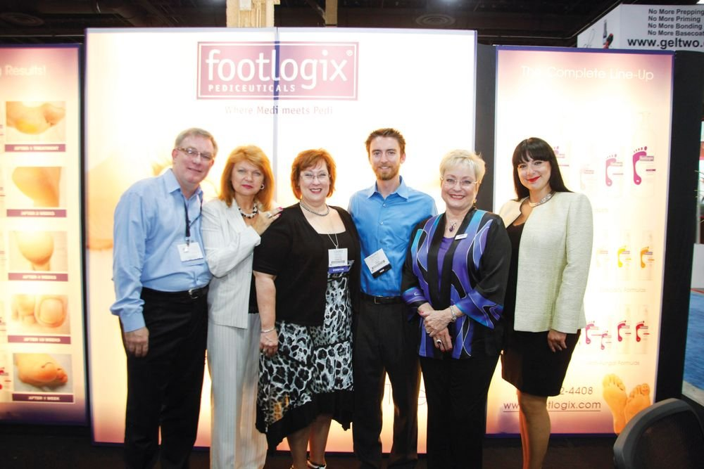 <p>The FootLogix team of Murray Smith, Eniko Campbell, Vicki Malo, Dr. Katharin von Gavel, and Tanya Palladina showed NAILS&rsquo; Tim Crowley (center) their new products.</p>