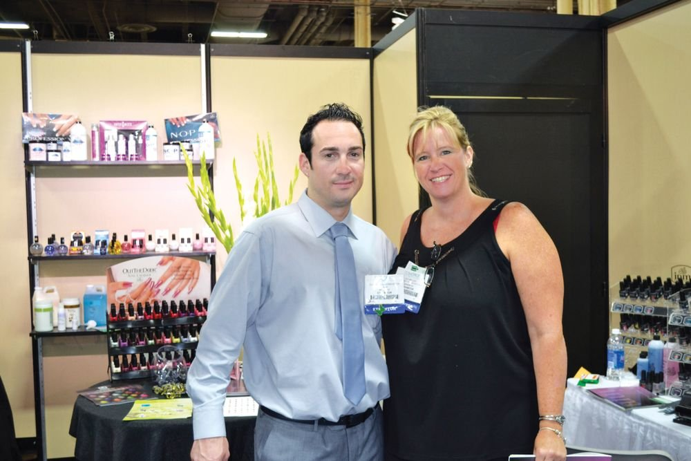 <p>INM&rsquo;s Garret Kellenberger poses with the new head of education at INM Juli Miller.</p>