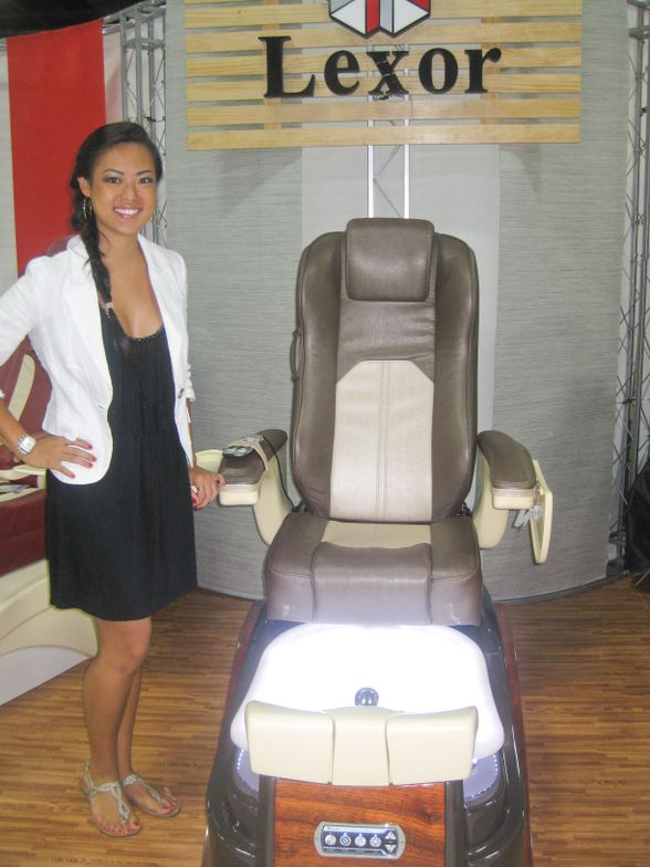 <p>Christine Nguyen stands by a Lexor pedicure spa prototype that features a more private design with greater wingspan.</p>