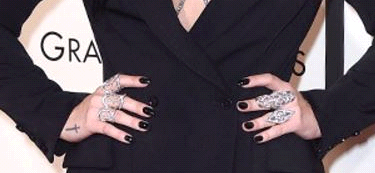 <p>Celeb manicurist Brittni Rae used a glass nail file to give Demi Lovato a soft oval shape and used Red Carpet Manicure Black Stretch Limo gel-polish for the Grammys. Image via @SHOPpr</p>