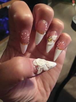 <p>TAOND student Denise Salvaggio created these pointy nails.</p>