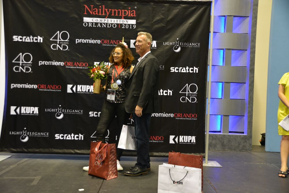 <p>Winner of winners, Division 2, Odette Guzman Fontanez with Richard Hurter</p>