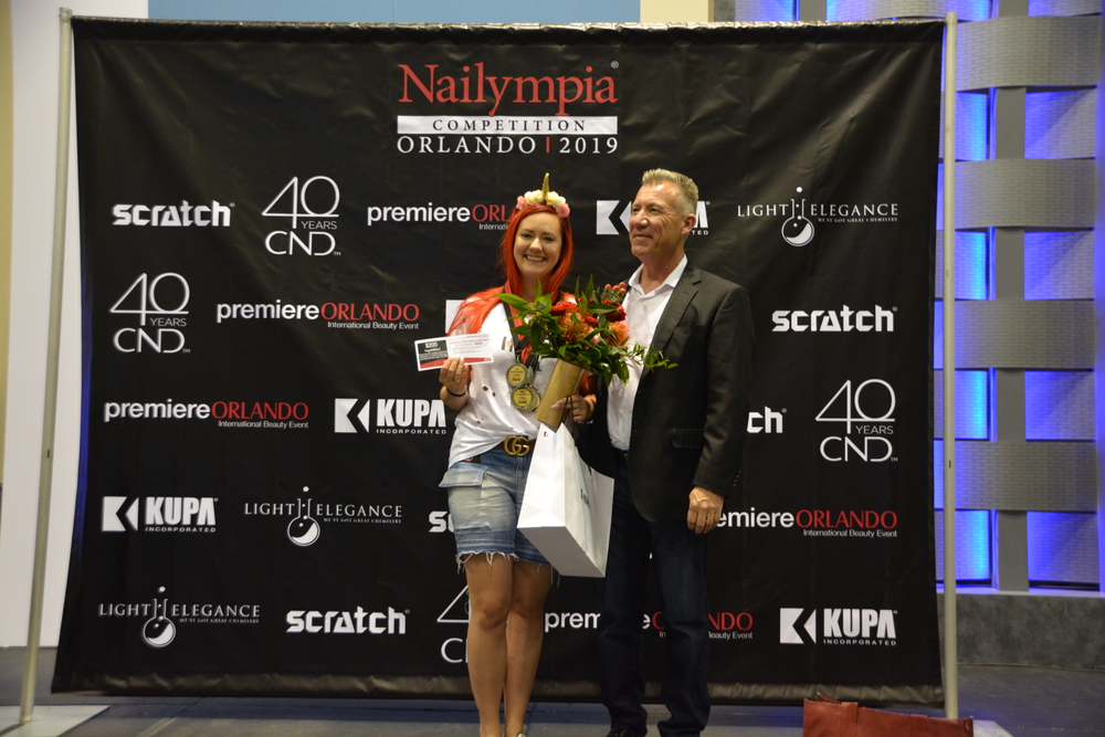 <p>Winner of Winners Division 3, Joanna Bandurska, with KUPA's Richard Hurter</p>