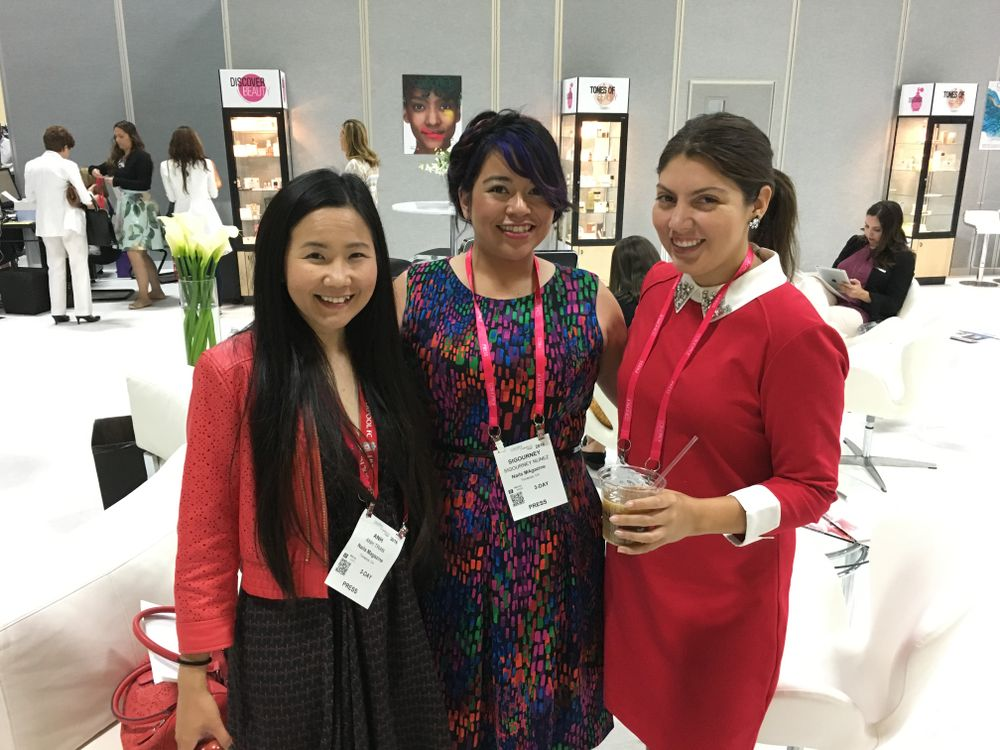 <p>In the press room prior to the beginning of the show: VietSALON managing editor Anh Tran, NAILS associate editor Sigourney Nunez, and senior editor Beth Livesay</p>