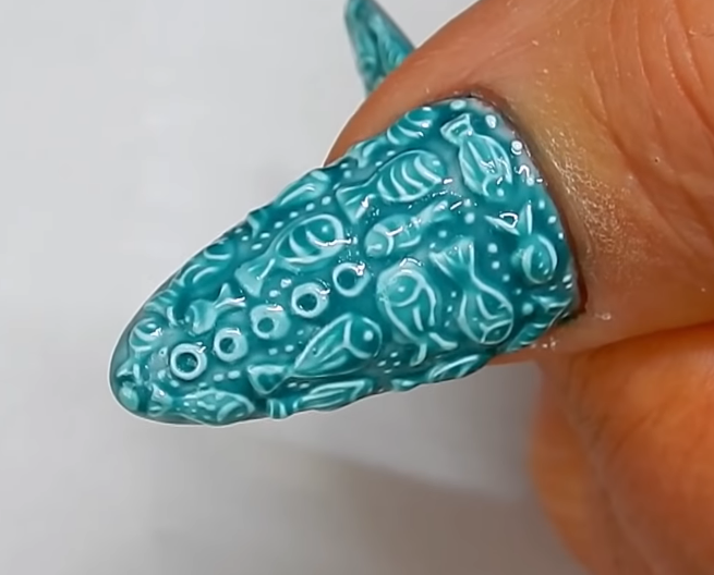 Glazed Pottery Nail Art With Fish Design