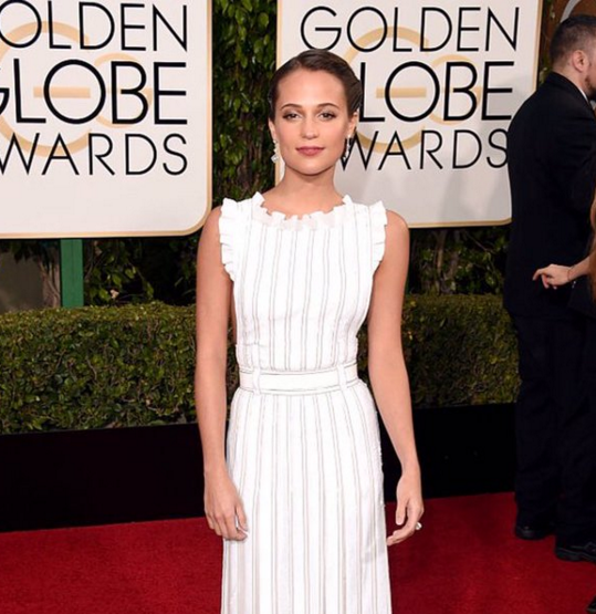 <p>Alicia Vikander was a vision in white and used a sheer shade in Lippmann's Bring on the Bling for the Golden Globes.</p>