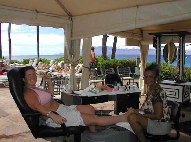 <p>Getting an outdoor pedicure in Hawaii (in my bikini!). Did we really run this photo in the magazine?</p>