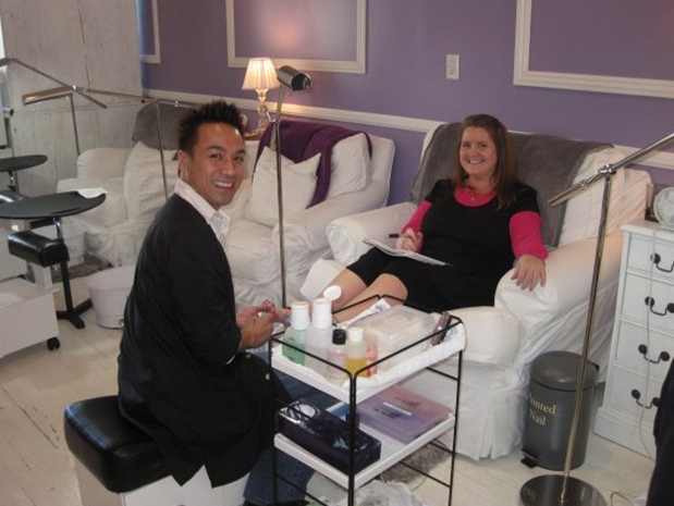 <p>At Katie Cazorla's first The Painted Nail locataion in Studio City, Calif., with nail tech Tom Nguyen.</p>