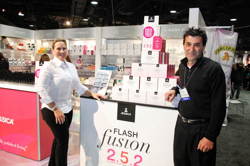 <p>Kandace Astamendi and Peter Sarkissian next to Jessica&rsquo;s new Flash Fusion 2.5.2 color activator polishes.</p>
