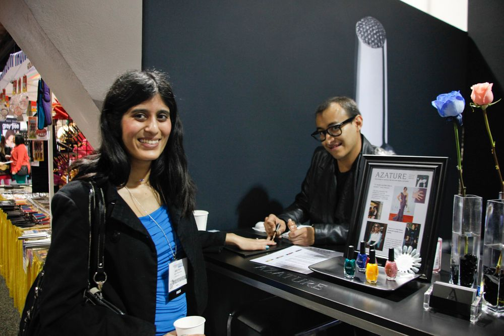 <p>NAILS managing editor Sree Roy tries out Azature polish applied by educator Brian Garces.</p>