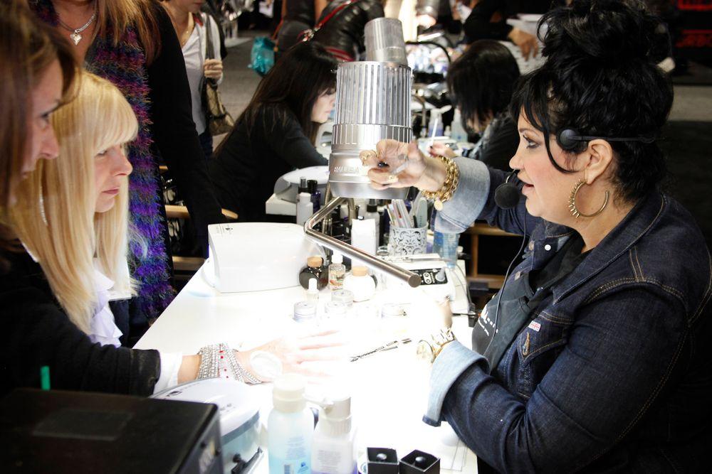 <p>Young Nails&rsquo; Melissa De La Cruz demonstrates Young Nails Synergy Gels.</p>
