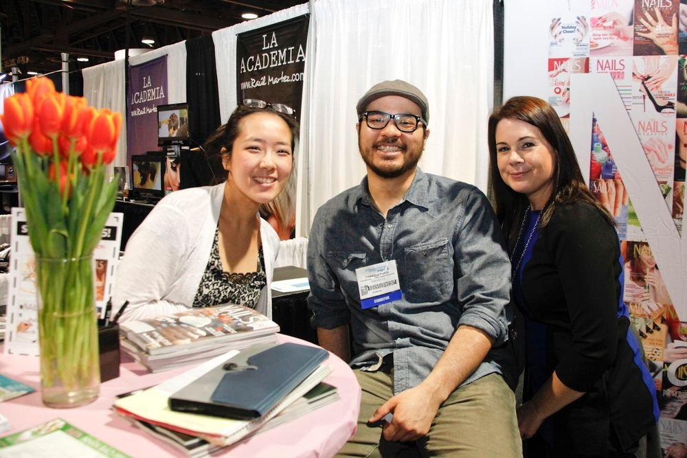 <p>NAILS graphic artist Yuiko Sugino, web producer Jonathan Chang, and sales &amp; marketing coordinator Amy Maletic enjoyed their first beauty trade show.</p>