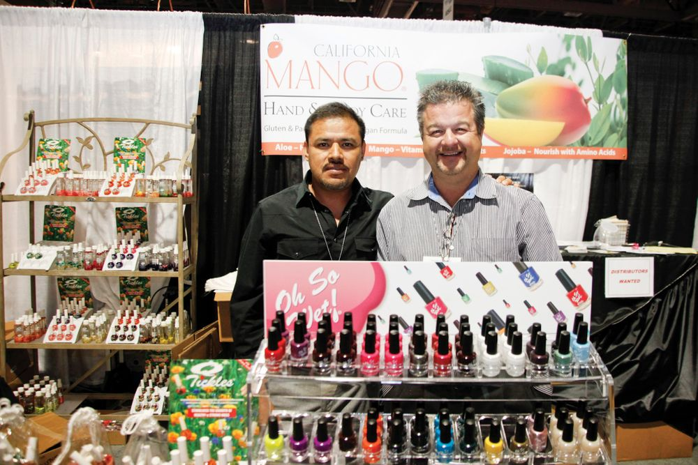 <p>California Mango&rsquo;s Leo Esquivel and Rudy Lenzkes pose for a photo behind their newly acquired Oh So Wet! Polish and Q-Tickles cuticle oils.</p>