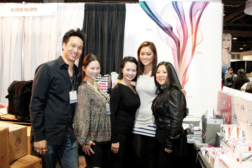 <p>Hollywood Nail Supply&rsquo;s Michael Hahn, Staphanie Cao, and Kimthi Cao shared booth space with Entity Beauty educators Roxanne Huynh and Dee Nguyen.</p>