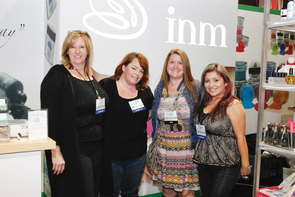 <p>NAILS editor Hannah Lee (second from right) chatted with Juli Miller, Colleen Ramsey, and Roxy Carillo about the latest offerings from INM.</p>