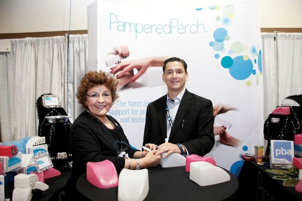 <p>Mother and son team Theresa and Mario Cantu debuted their new ergonomic hand support, Pampered Perch. Theresa is a long-time nail tech who developed the product out of a need in her salon.</p>