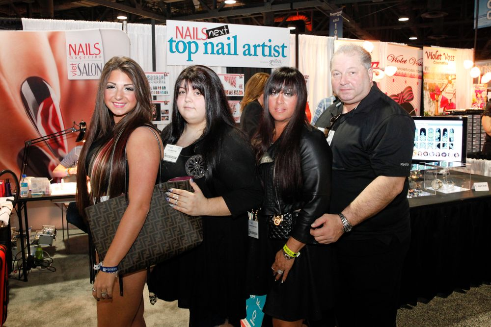 <p>The entire Martone family pays a visit to the NAILS booth.</p>