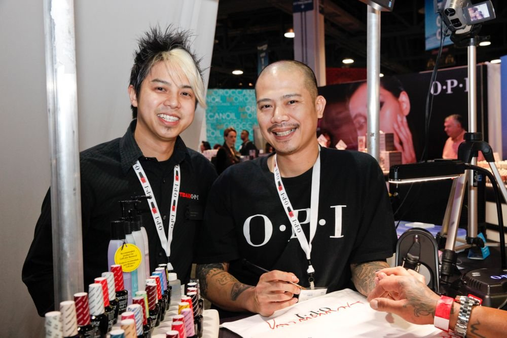 <p>Brothers Robert and Vu Nguyen both showed off their artistic skills at the OPI booth.</p>