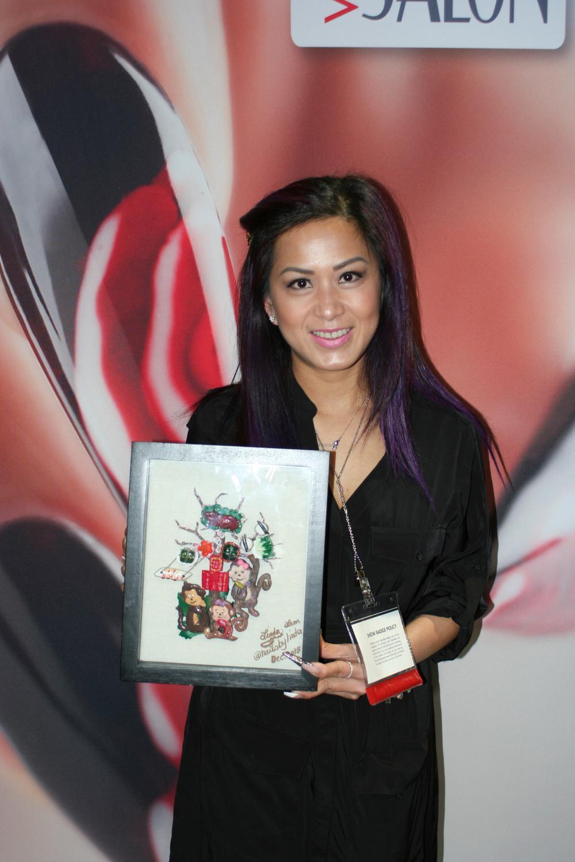 <p>Linda Lam, the winner of VietSALON Magazine's Year of the Monkey nail art contest with her winning masterpiece</p>