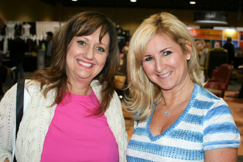 <p>Vivian Schaffer and Dana Dubell of Aida Grey Beauty Salon in Encino, Calif., visit the NAILS booth.</p>